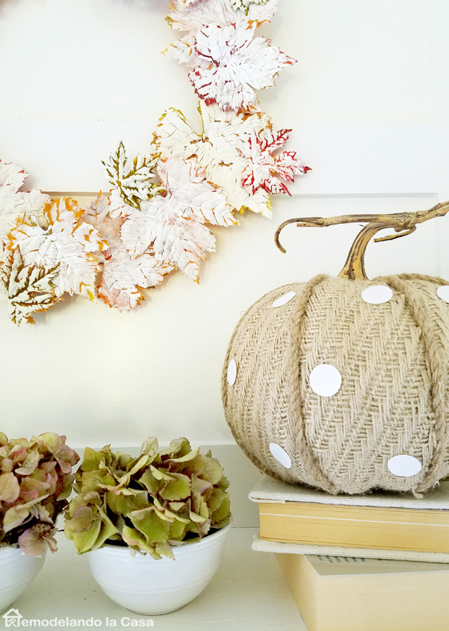 green hydrangeas, old white books, mantel, rustic pumpkin
