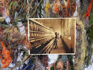 part of Susan Lenz's installation -- multicolored thread covering a self-sustaining column display and a sepia image depicting a woman working in a textile factory