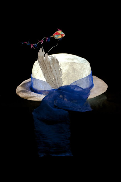 paper hat with kite ornament and blue organdy ribbon on brim