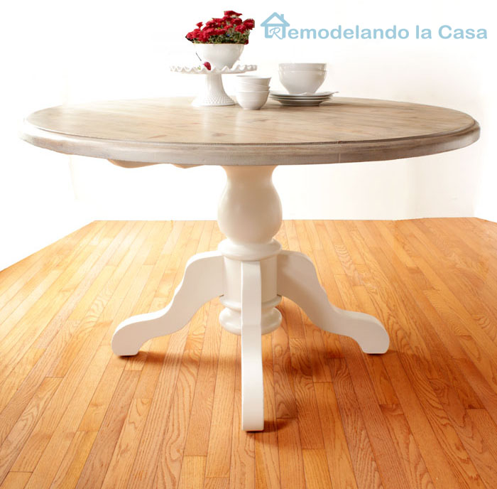 Pedestal kitchen table with white painted base and stained top.