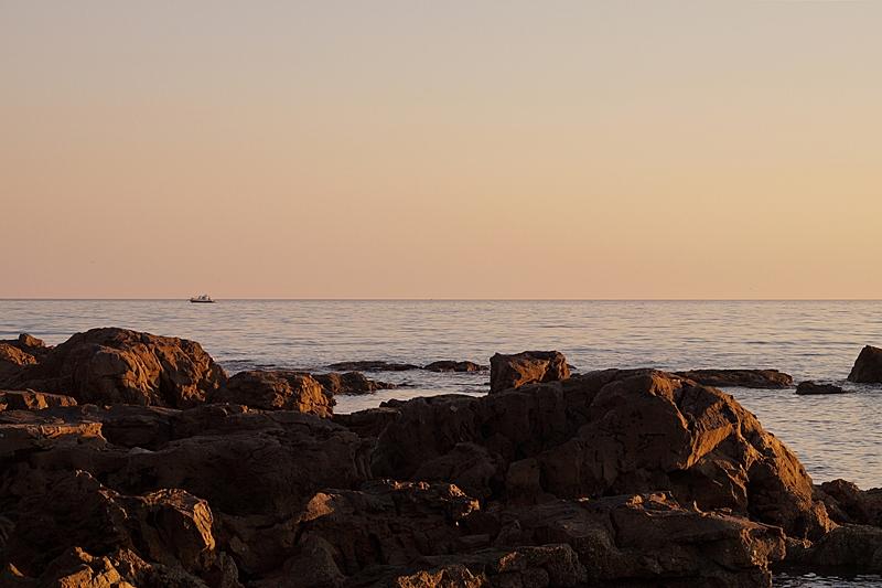 rocks at Croatias sea coast in the evening light