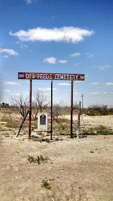 A photo of the Old Pecos Cemetery entrance.