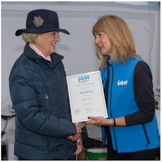 Sarah Sillars of IAM RoadSmart presents certificate to Mary Berry