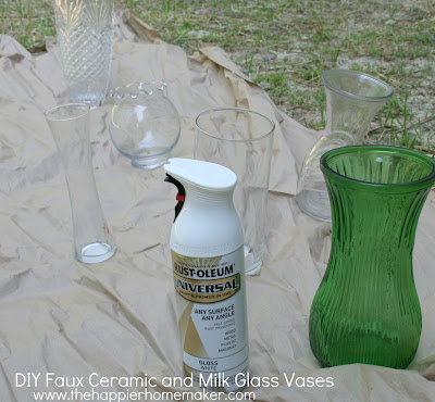 An in progress picture of several vases that are clear or colored before being painted white