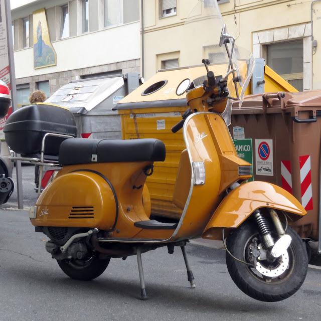 A yellow Vespa in Via Fiume, Livorno