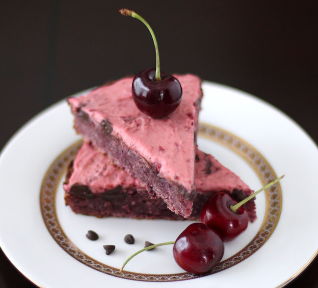 These Healthy Cherry Chocolate Chunk Blondies are topped with a delicious Cherry Frosting. They're chewy and moist but without the butter, eggs, and sugar!