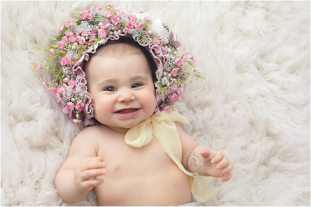 Flower bonnets make your baby photography session extremely special.