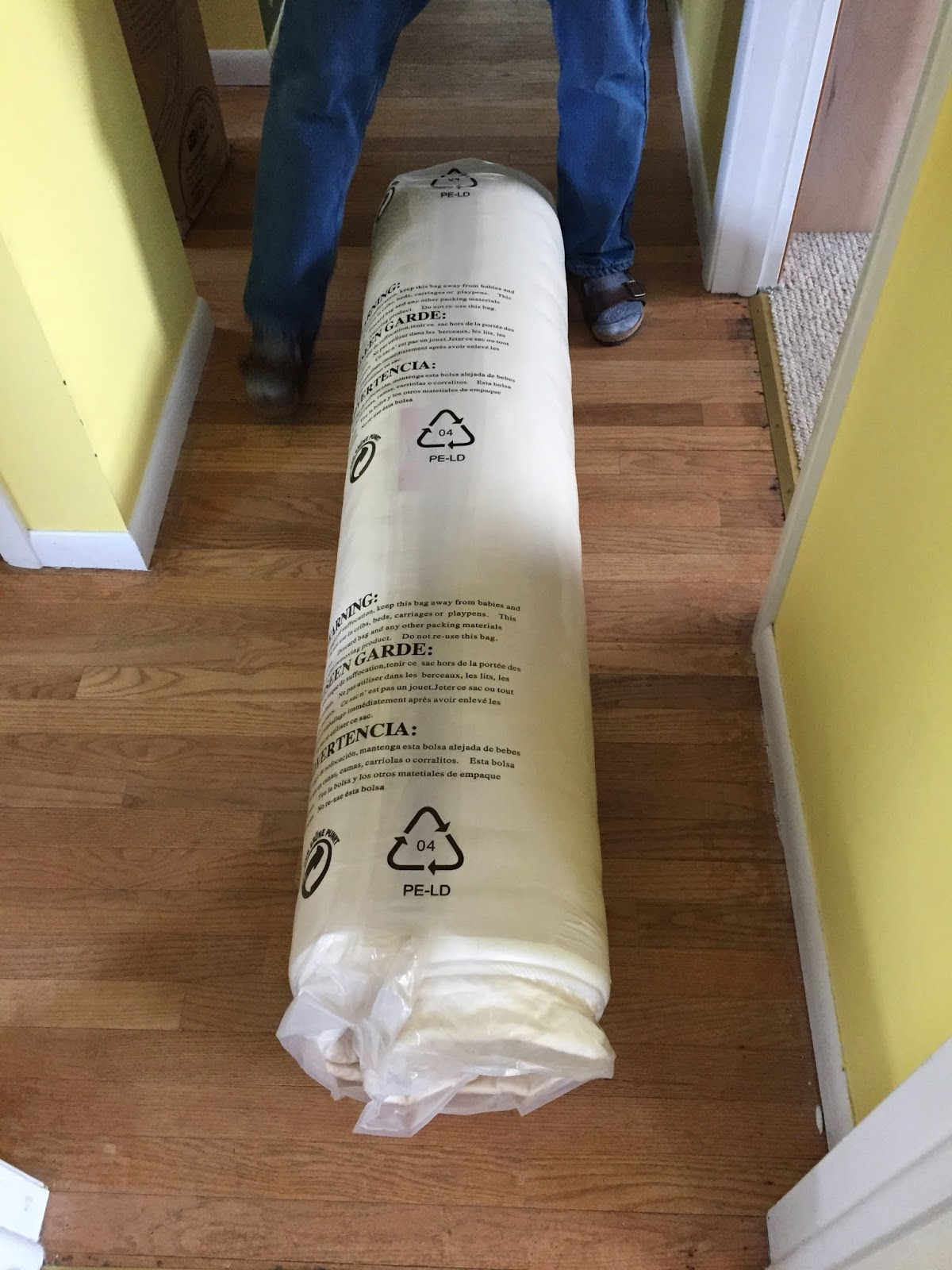 Photo of the mattress vacuum packed and rolled.