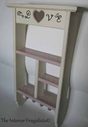 Vintage wooden wall shelf with stencil detail on the shelves