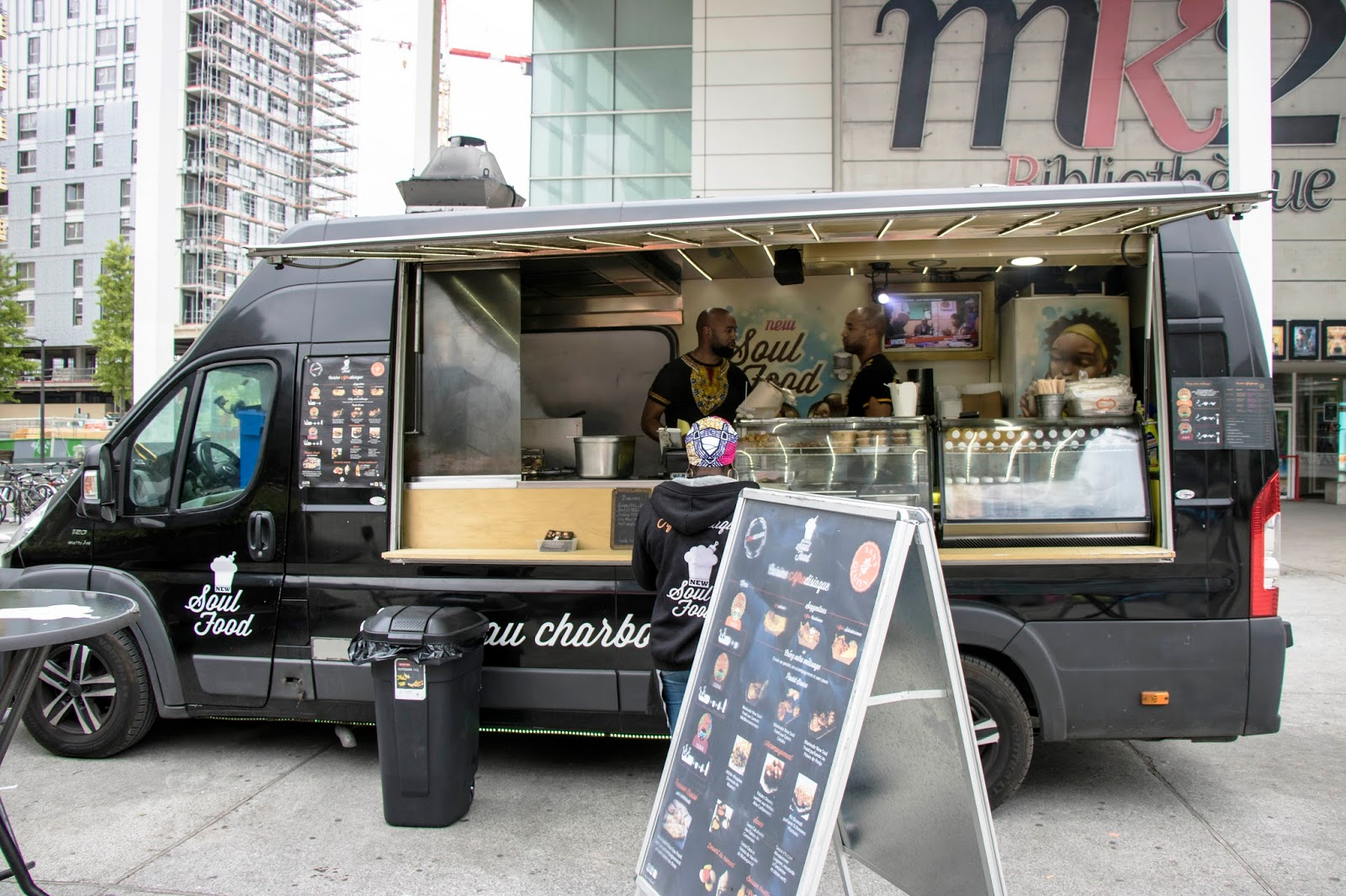 New Soul Food food truck viewed from the plaza © Discover Paris! New Soul Food's cuisine is best described as Afro-fusion. The menu revolves around chicken ...