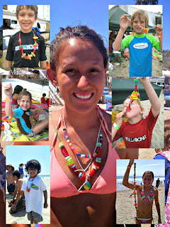 Camp director Amanda Beene and six campers wearing candy lei necklaces at Aloha Beach Camp