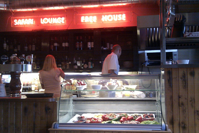 A busy bar and kitchen at the Safari Lounge.