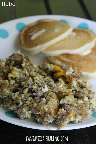 Hobo // This recipe scrambles up all kinds of breakfast goodness, like sausage, eggs, and hashbrowns. #recipe #breakfast #eggs #sausage