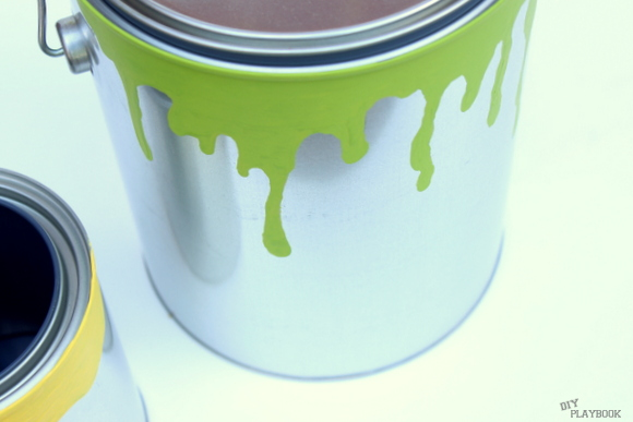 Adding drips to your paint can planter will make it seem more realistic.