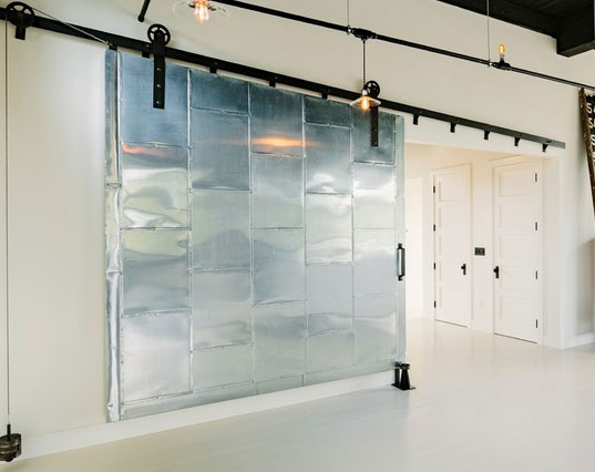 image result for huge silver steel sliding barn door in contemporary room