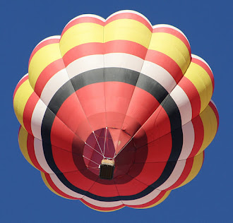 Hot air balloon floating above our home.
