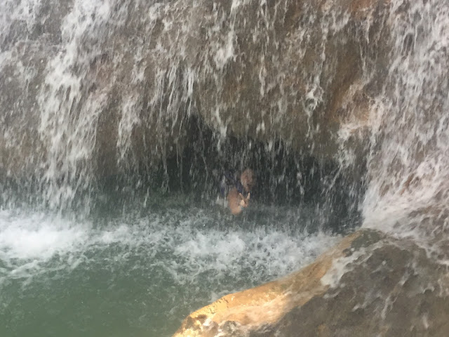Swimming in a waterfall