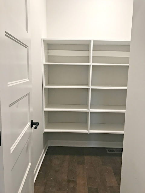 walk in pantry with melamine shelves
