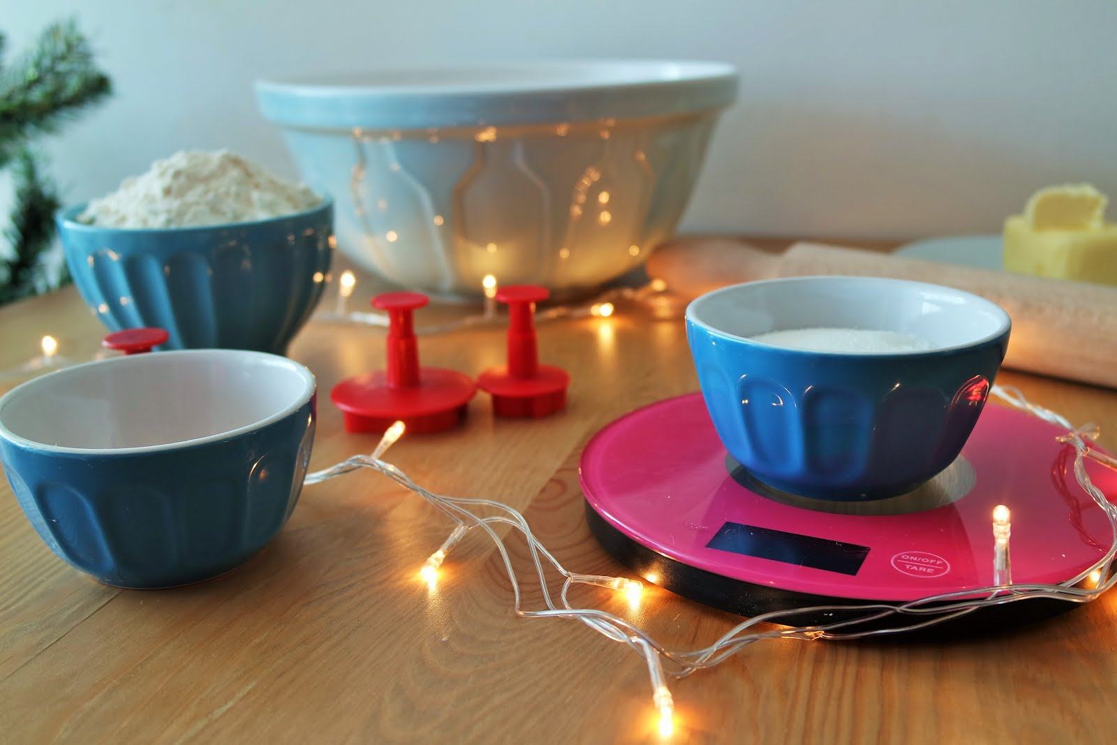 Christmas cookies recipe: Ingredients set out on a table with fairy lights