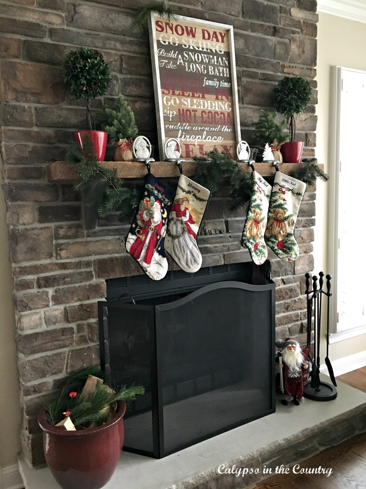 Stone Fireplace with Rustic Sign for Christmas