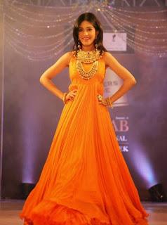 Amrita Rao's Ramp Walk in Orange Gown