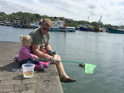Sitting on the harbour wall with a net