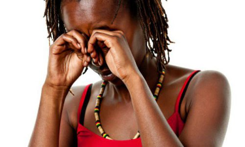 Black African woman crying