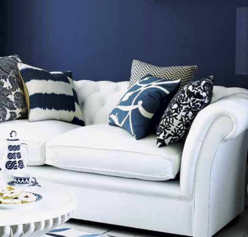 Navy and white coastal living room, white slipcover sofas.