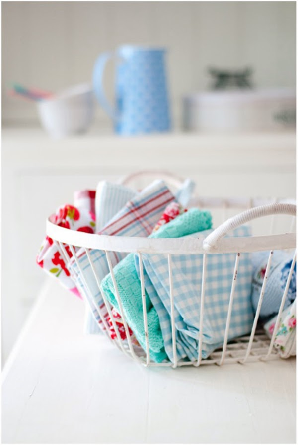 a basket of kitchen linens