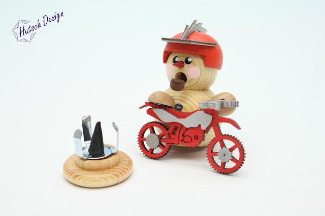 https://www.volkskunst-seiffen.de/Biker-natur-mit-rotem-Crossmotorrad-8cm.html