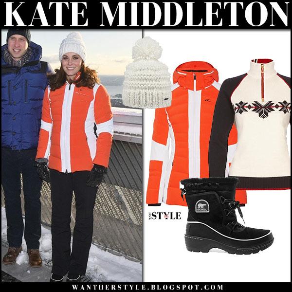Kate Middleton in orange puffer kjus jacket, black snow boots and white beanie winter snow fashion royal family february 2