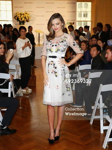 Miranda Kerr wore a white floral belted dress