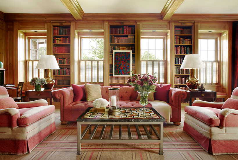 Rose tufted sofas in panelled library Meadowmere Southampton home by Carrier and Company