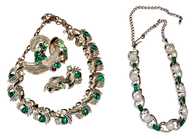 Two costume jewellery necklaces of gold-dipped chain, pearl and green rhinestones.
