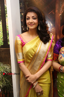 Actress Kajal Agarwal Stills in Golden Silk Saree at Trisha Sesigner Store Launch  0073.jpg