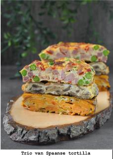 Torentje van drie tortillas: Paisana: met ham, erwten en paprika  Champignons  Zoete aardappelen met bosui   Ook verkrijgbaar helemaal vegetarisch.