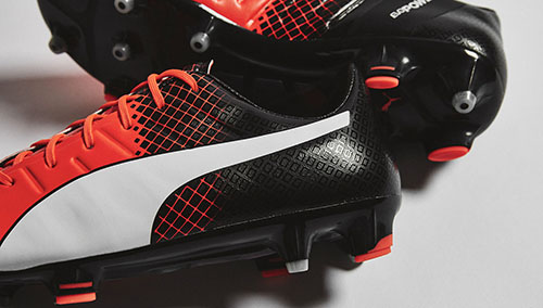 Puma-evoPOWER-1.3-with-Shocking-Orange-Black-and-White-3