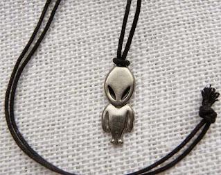 serious alien pendant necklace