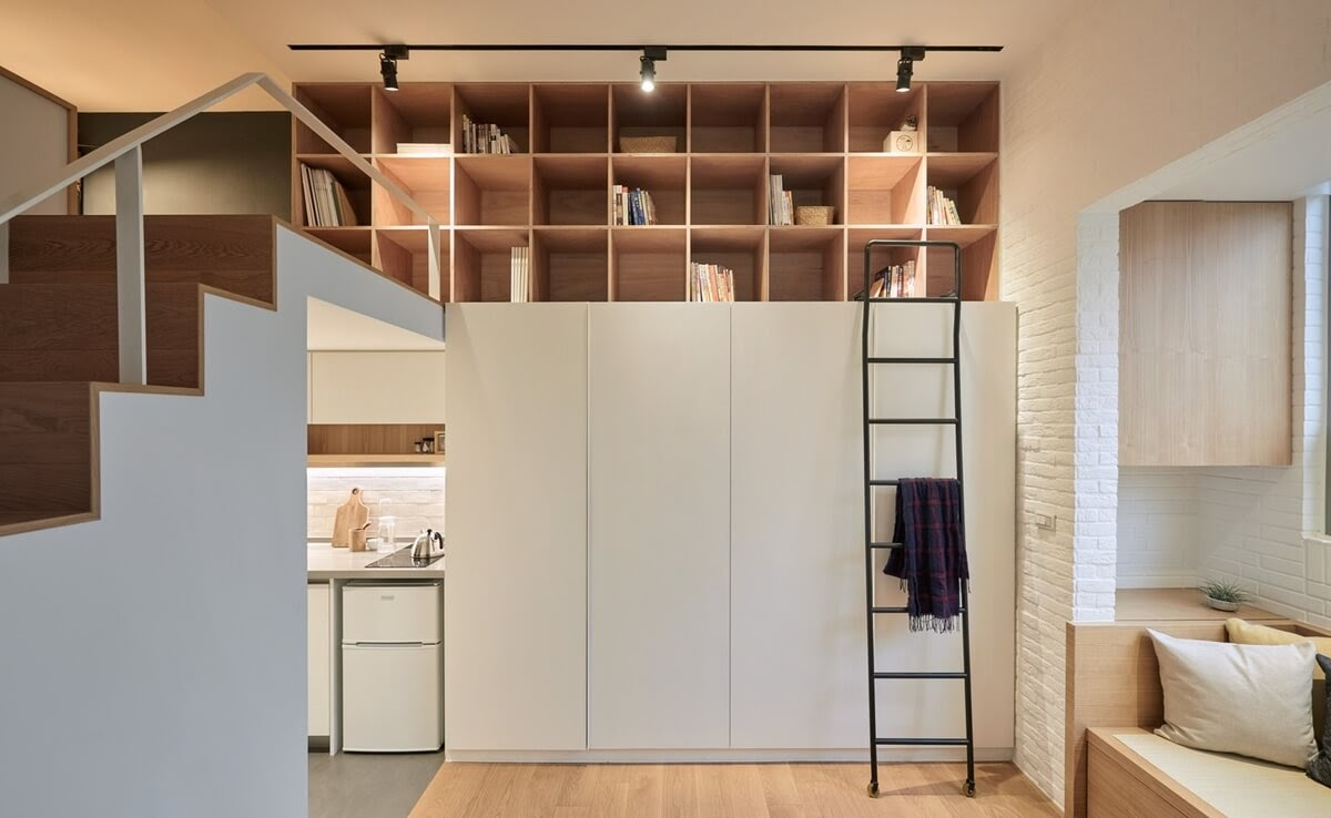 02-Wardrobe-and-Stairs-to-Bedroom-A-Little-Design-Tiny-Apartment-Smart-Design-Renovation-www-designstack-co