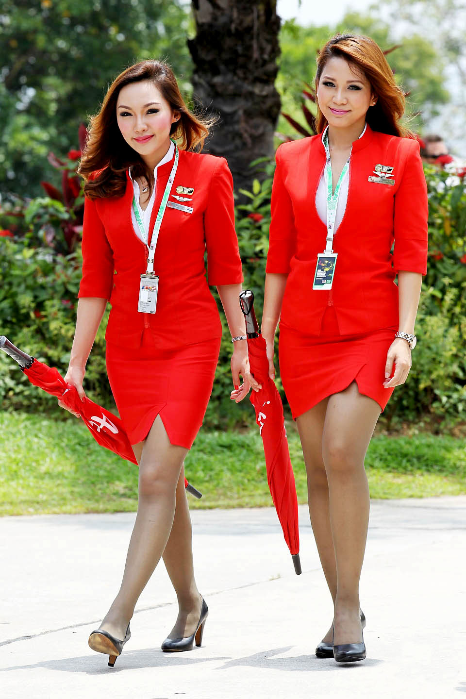 Two Malaysian ruling-party lawmakers have chided homegrown airlines AirAsia and Firefly for dressing their stewardesses in uniforms that are 'too revealing'.<br>