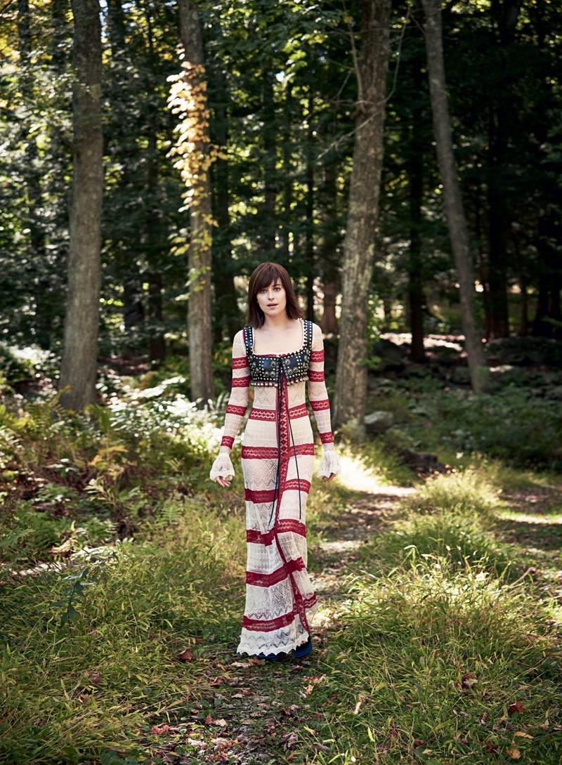 Dakota Johnson wears Alexander McQueen dress and leather harness