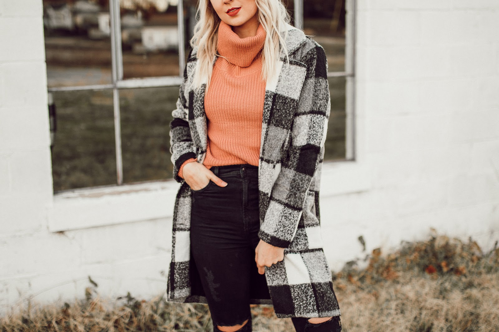 plaid coat over a turtleneck sweater