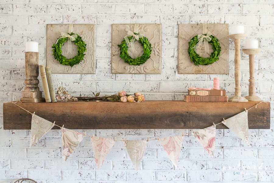brick fireplace with wood mantel and spring decor