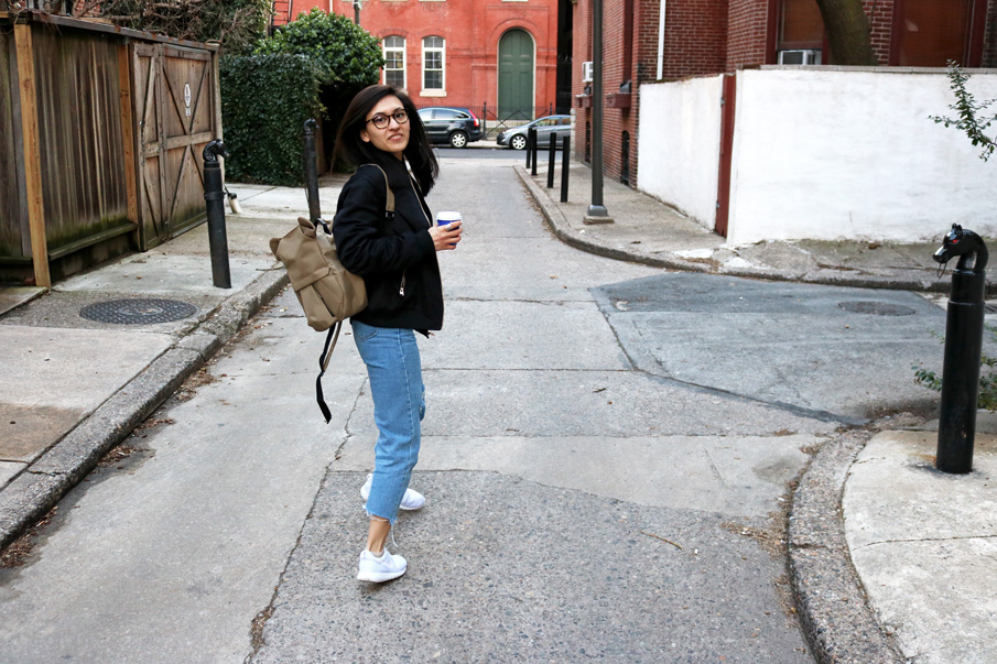 Black Bomber Jacket, Mom Jeans, White Sneakers, Khaki Backpack