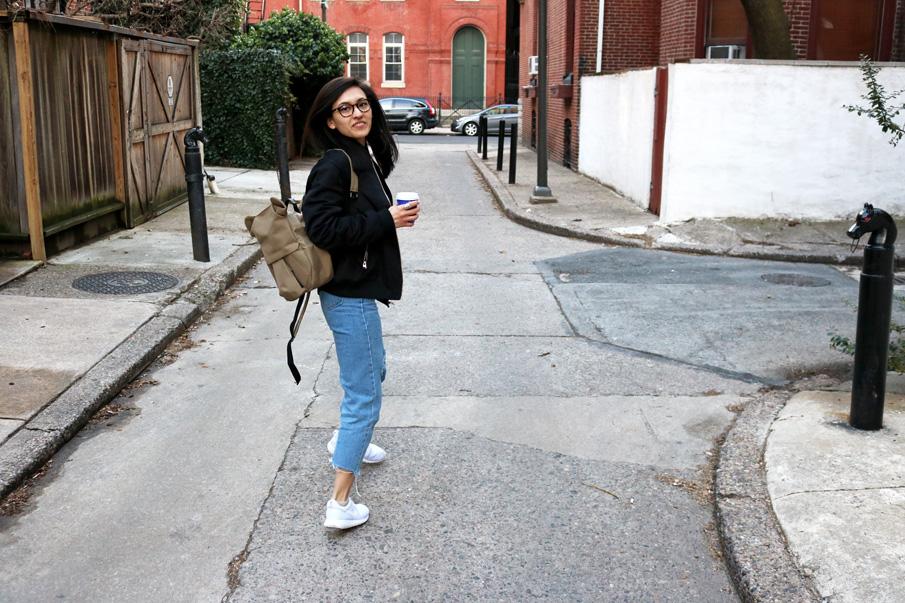 Black Bomber Jacket, Mom Jeans, White Sneakers, Khaki Backpack
