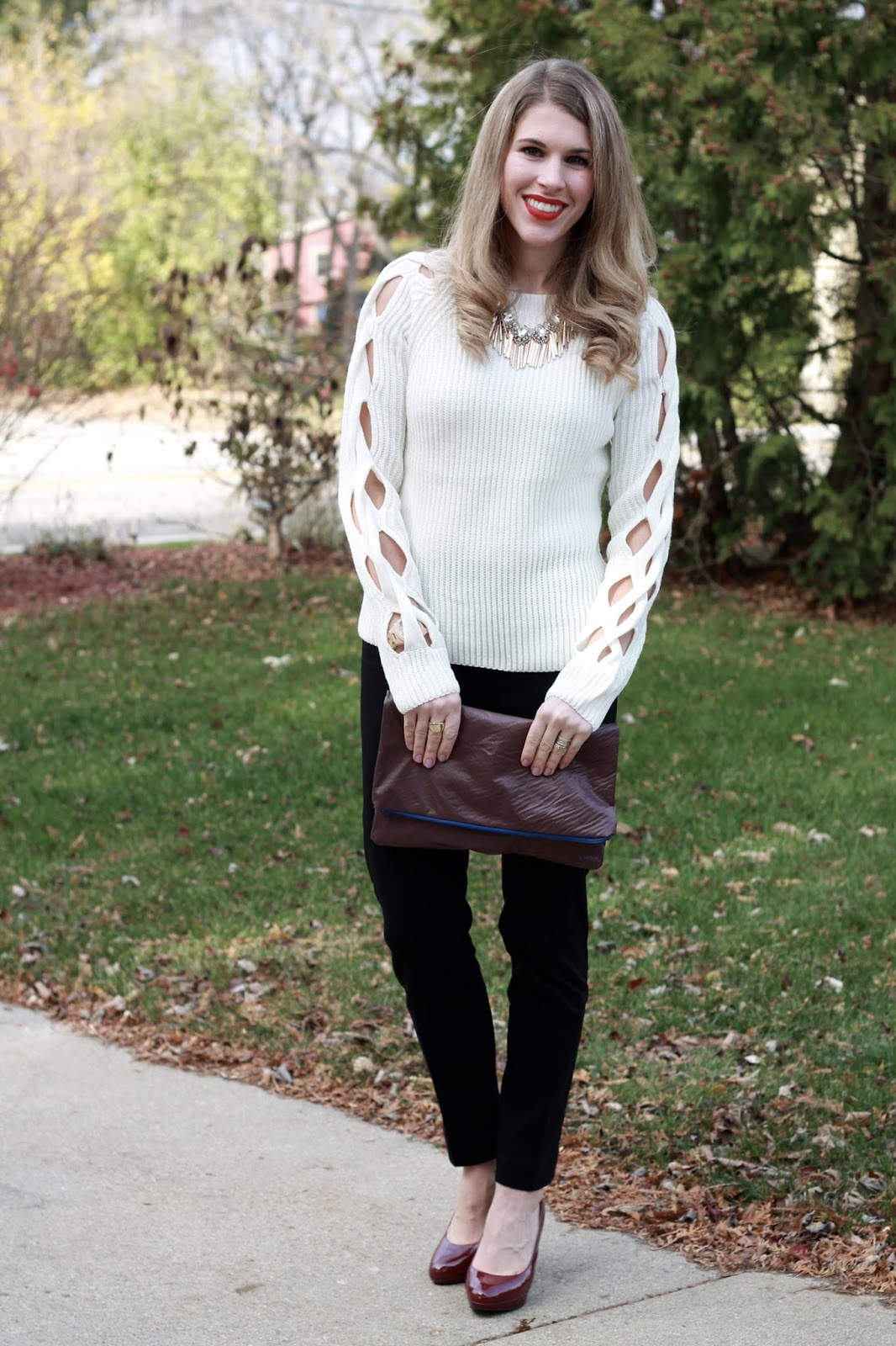 White crisscross sweater, Slimstation black ankle pants, burgundy clutch, burgundy heels
