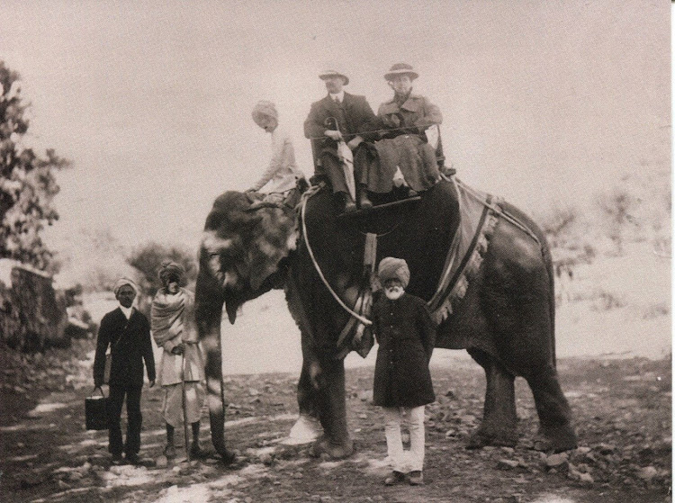 Couple Travelling in India on an Elephant