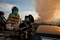 Air pollution in Sumatra in 2013, where peatlands were burned to clear land for a palm-oil plantation. (Credit: Ulet Infansasti/Greenpeace) Click to Enlarge.