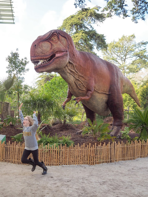 girl running from t-rex