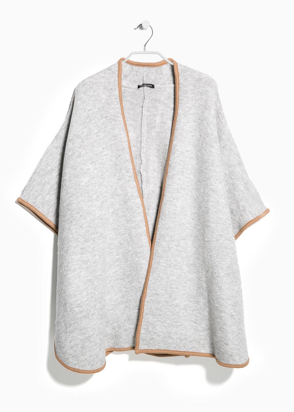 http://shop.mango.com/GB/p0/women/clothing/cardigans-and-sweaters/cardigans/trim-knit-cape/?id=33087603_37&n=1&s=prendas.cardigans&ident=0__0_1415568012196&ts=1415568012196